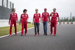Sebastian Vettel, Ferrari, Antonio Giovinazzi, Ferrari and Riccardo Adami, Ferrari Race Engineer walk the track