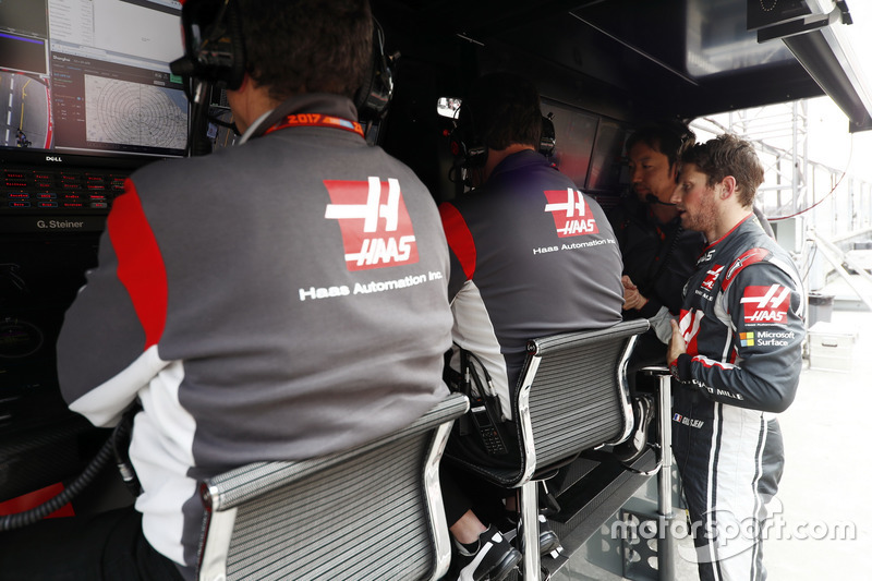 Romain Grosjean, Haas F1 Team, on the pit wall