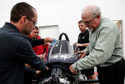 Jeff Horton, INDYCAR Director of Engineering/Safety, installs a windscreen on the 2018 Indy car in preparation for the first test