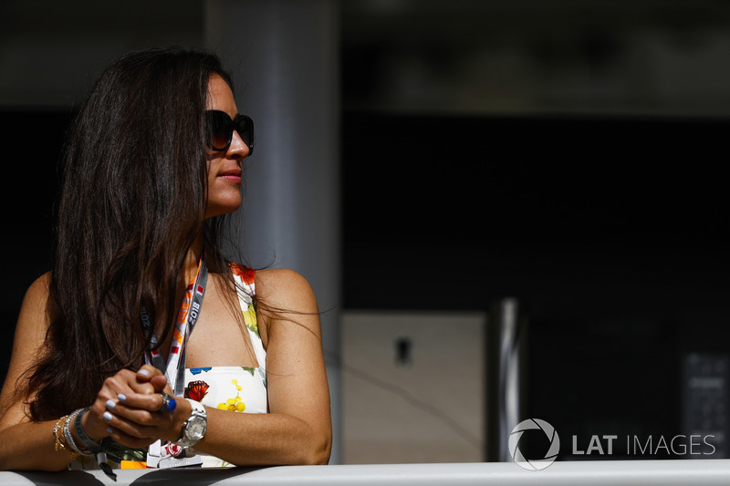 A fan watches from near the garages