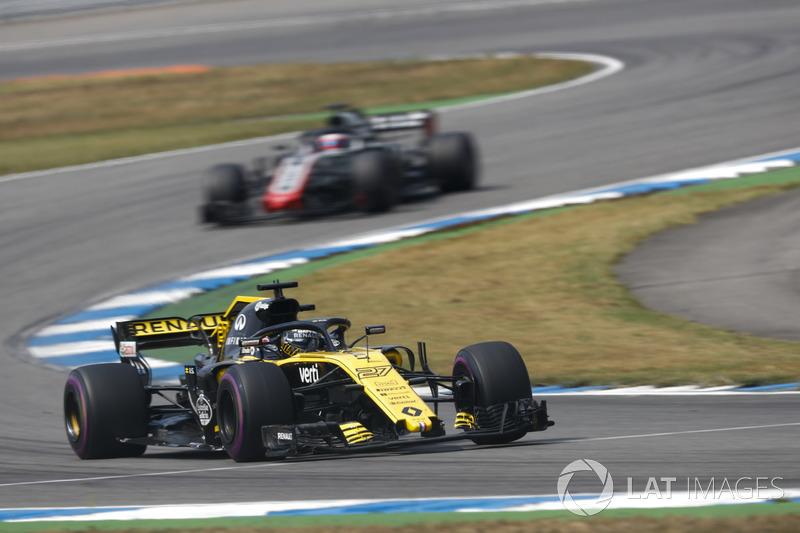 Hulkenberg passes two battling cars in one go