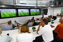 A gathering around screens for the England v Sweden World Cup game