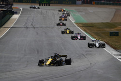 Nico Hulkenberg, Renault Sport F1 Team R.S. 18, leads Charles Leclerc, Sauber C37, and Esteban Ocon, Force India VJM11