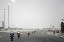 Moto3 bikes exiting pit lane