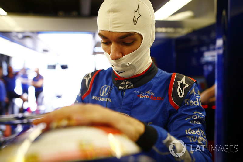 Pierre Gasly, Toro Rosso, adjusts his helmet.