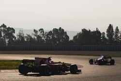 Sebastian Vettel, Ferrari SF70H, follows Carlos Sainz Jr., Toro Rosso STR12