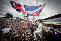 Race winner Lewis Hamilton, Mercedes AMG F1, celebrates victory with the fans