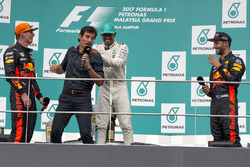 Race winner Max Verstappen, Red Bull Racing, Mark Webber, Lewis Hamilton, Mercedes AMG F1 and Daniel Ricciardo, Red Bull Racing celebrate on the podium