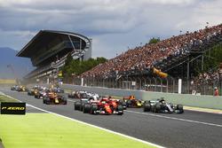 Sebastian Vettel, Ferrari SF70H, Lewis Hamilton, Mercedes AMG F1 W08, lead at the start of the race