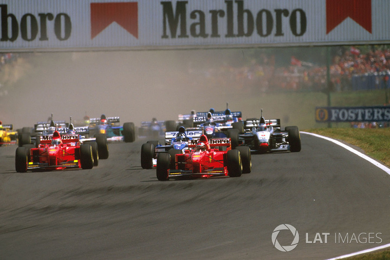 Michael Schumacher, Ferrari F310B, Damon Hill Arrows A18 Yamaha and Eddie Irvine, Ferrari F310B