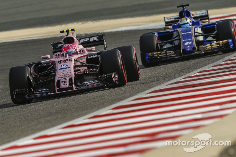 Esteban Ocon, Force India VJM10, leads Marcus Ericsson, Sauber C36