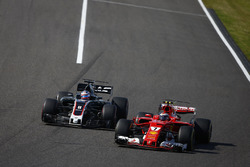 Kimi Raikkonen, Ferrari SF70H, battles with Romain Grosjean, Haas F1 Team VF-17