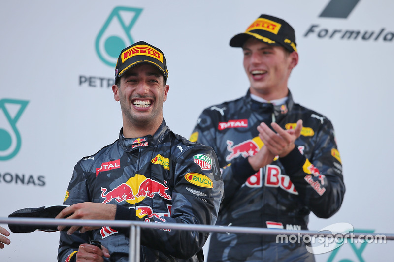 (L to R): Race winner Daniel Ricciardo, Red Bull Racing celebrates on the podium with second placed