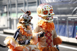 Day of the Dead costumes are worn in the paddock