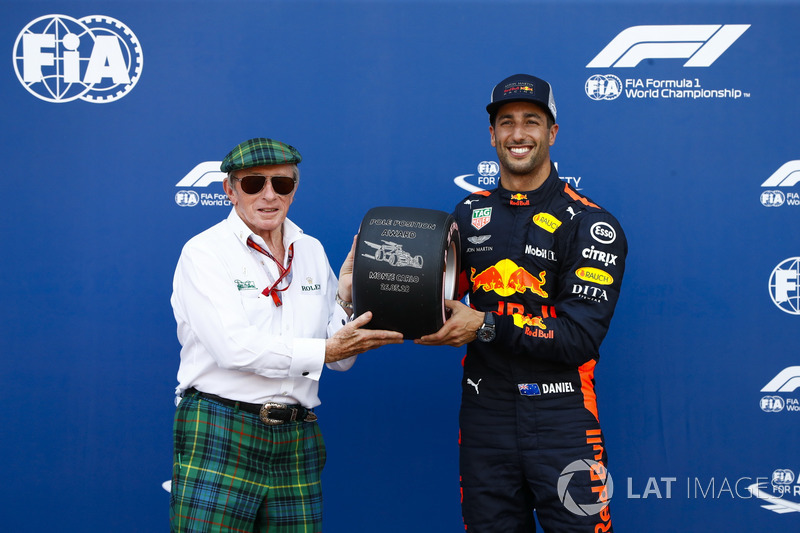 Daniel Ricciardo, Red Bull Racing, receives the Pirelli pole position trophy from Sir Jackie Stewart