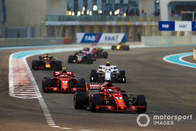 Sebastian Vettel, Ferrari SF71H, leads Kimi Raikkonen, Ferrari SF71H, and Charles Leclerc, Sauber C37, and Daniel Ricciardo, Red Bull Racing RB14