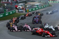 Kimi Raikkonen, Ferrari SF70H, Sergio Perez, Sahara Force India VJM10 and Esteban Ocon, Sahara Force India VJM10