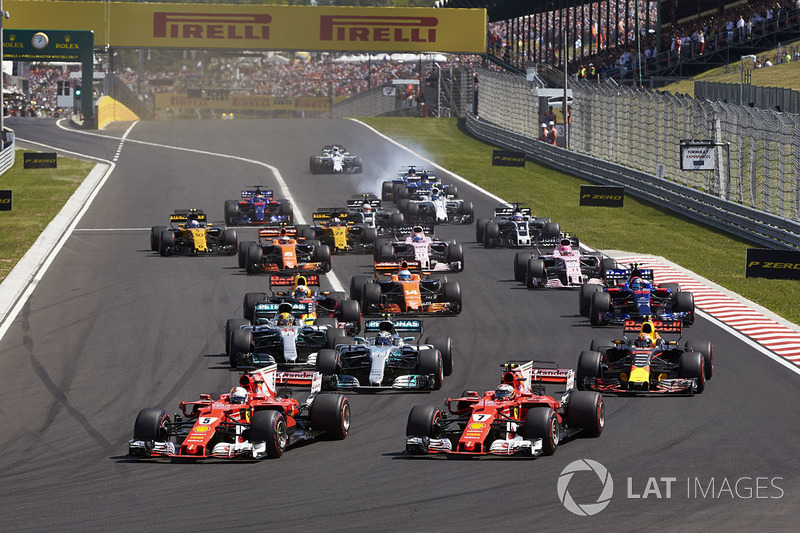 Sebastian Vettel, Ferrari SF70H, Kimi Raikkonen, Ferrari SF70H, lead the field away at the start