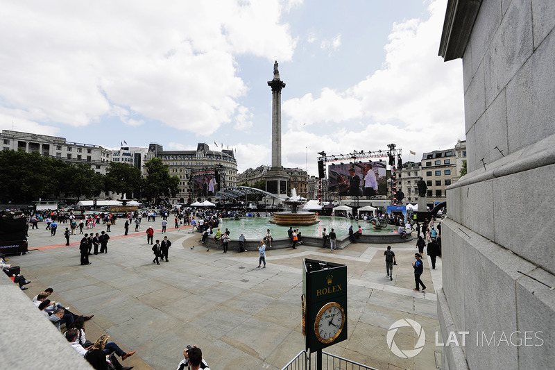 The big screens set up either side of Nelsons Column in Trafalgar Square