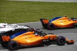 Stoffel Vandoorne, McLaren MCL33, leads Fernando Alonso, McLaren MCL33, and Sergey Sirotkin, William