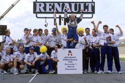 World Champion Jacques Villeneuve celebrates with his Williams team