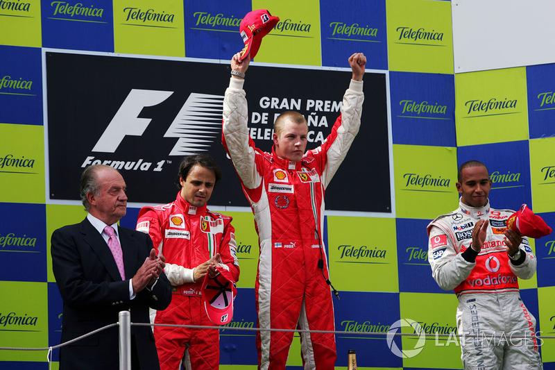 Podium: King Juan Carlos of Spain, race winner Kimi Raikkonen, Ferrari, second place Felipe Massa, Ferrari, and third place Lewis Hamilton,Mclaren on the podium