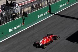 Sebastian Vettel, Ferrari SF70H crosses the line to take the chequered flag and win the race