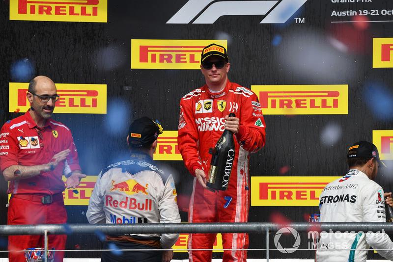 (L to R): Max Verstappen, Red Bull Racing, Carlo Santi, Ferrari Race Engineer, Race Winner Kimi Raikkonen, Ferrari and Lewis Hamilton, Mercedes AMG F1 celebrate on the podium with the champagne