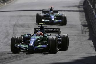 Rubens Barrichello, Honda RA107, 10th position, leads team mate Jenson Button, Honda RA107
