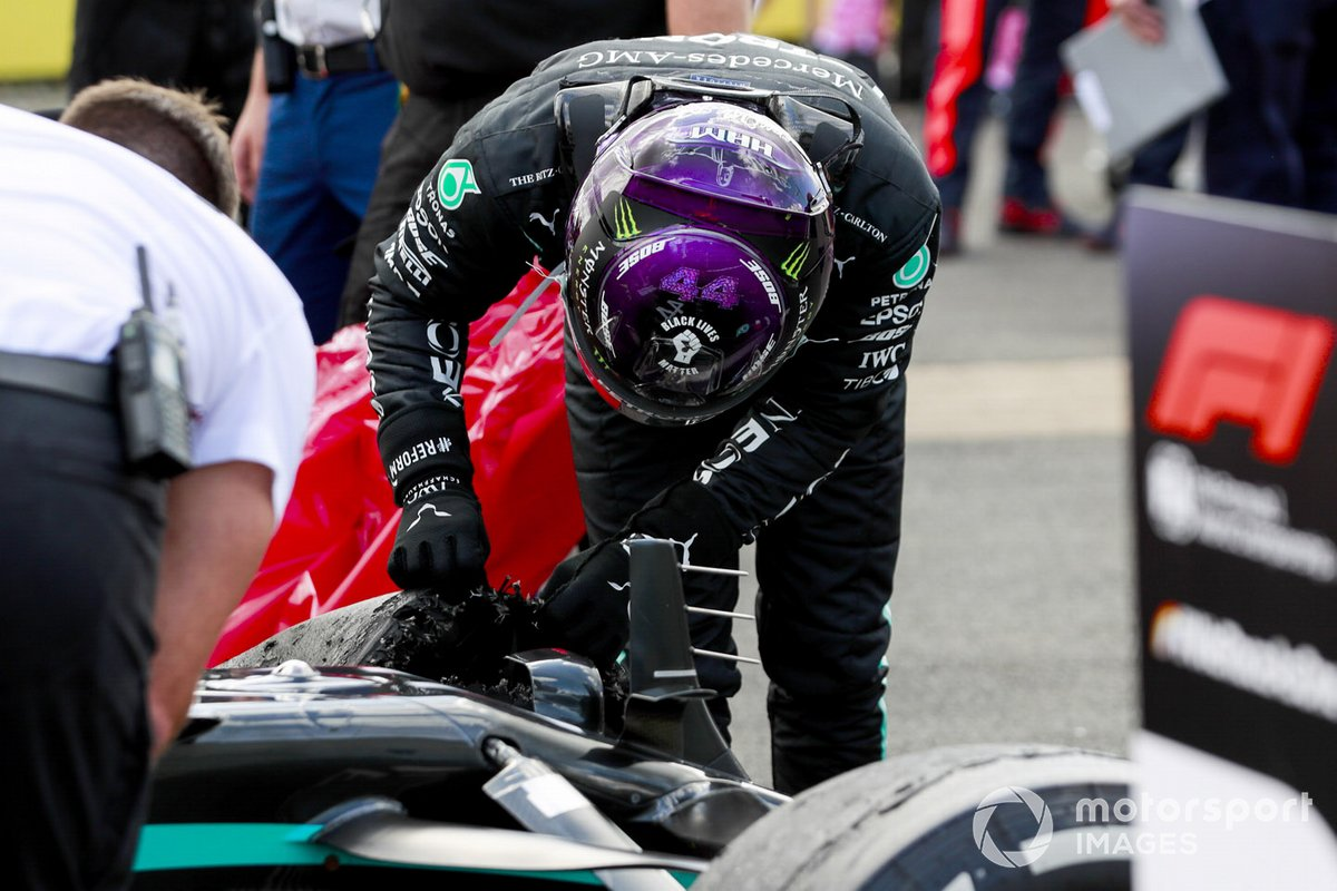 Race Winner Lewis Hamilton, Mercedes-AMG F1 looking at the damages tyre on hic car in Parc Ferme