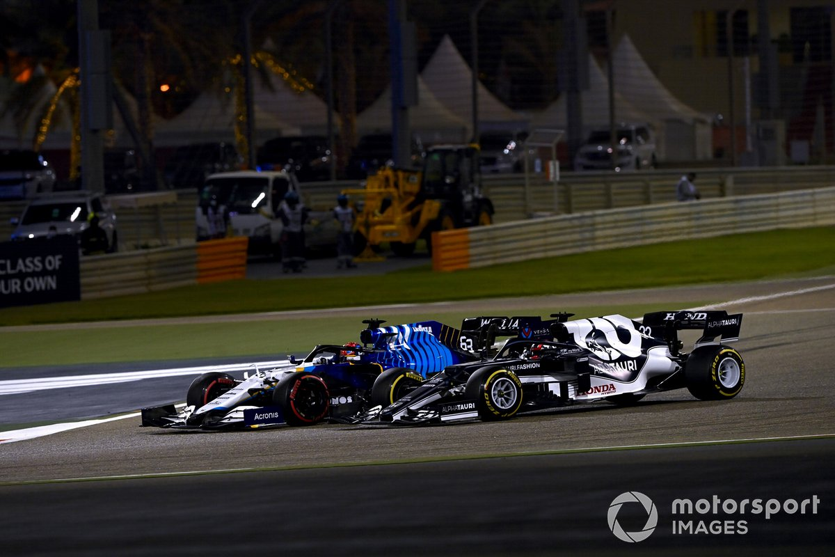 George Russell, Williams FW43B, and Yuki Tsunoda, AlphaTauri AT02, go off track whilst battling for position