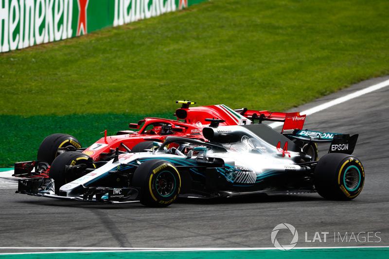 Lewis Hamilton, Mercedes AMG F1 W09, passes Kimi Raikkonen, Ferrari SF71H