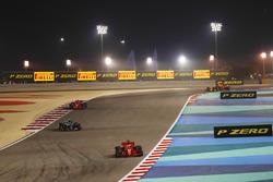 Sebastian Vettel, Ferrari SF71H, Valtteri Bottas, Mercedes AMG F1 W09, and Kimi Raikkonen, Ferrari S
