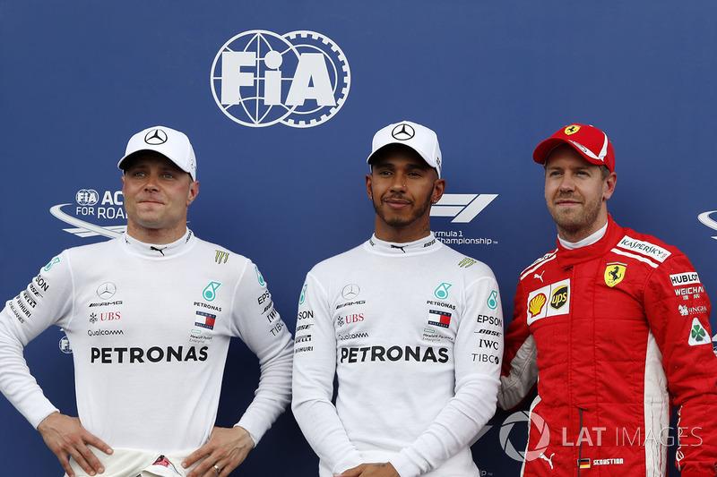 Valtteri Bottas, Mercedes-AMG F1, Lewis Hamilton, Mercedes-AMG F1 e Sebastian Vettel, Ferrari, nel parco chiuso