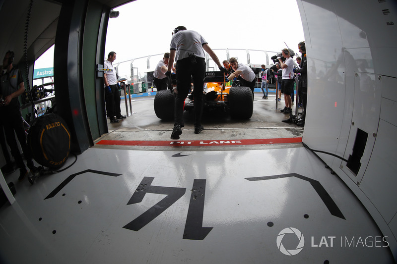 Fernando Alonso, McLaren MCL33 Renault, is returned to the garage