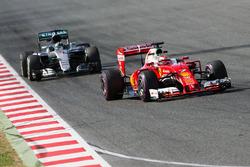 Kimi Raikkonen, Ferrari SF16-H leads Nico Rosberg, Mercedes AMG F1 W07 Hybrid