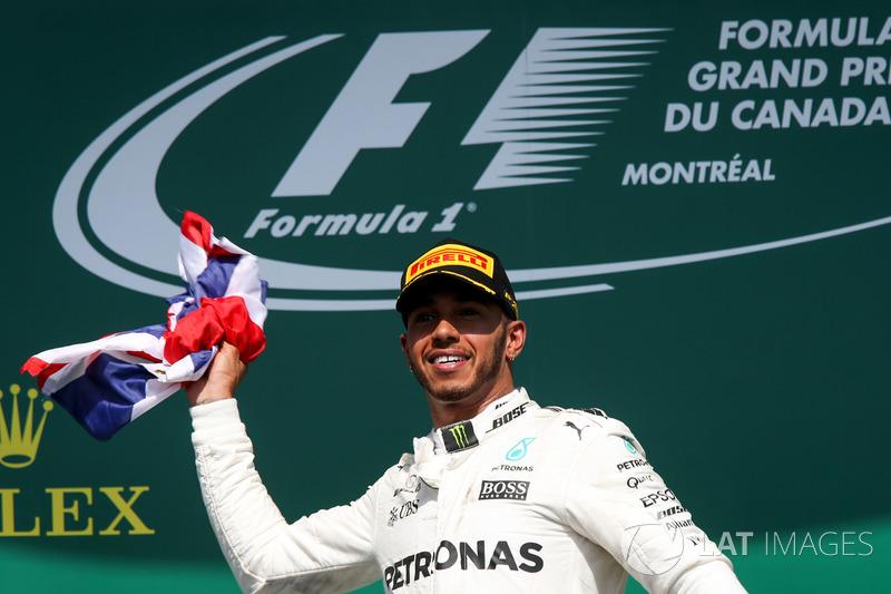 Race winner Lewis Hamilton, Mercedes AMG F1 celebrates on the podium, the Union Jack Flag
