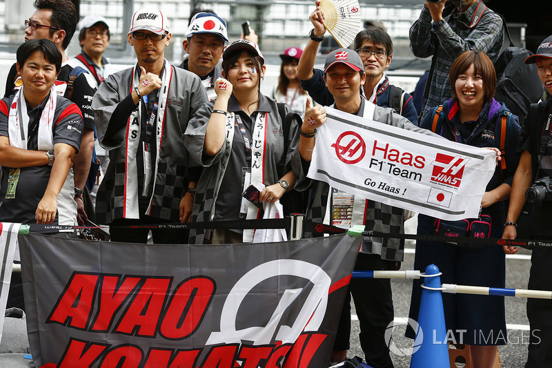 Fans with a banner for Ayao Komatsu, Chief Race Engineer, Haas F1 Team