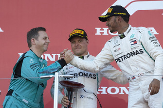 Lewis Hamilton, Mercedes AMG F1, celebrates his win on the podium with Valtteri Bottas, Mercedes AMG F1