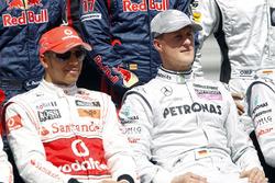 Lewis Hamilton, McLaren MP4-25, with Michael Schumacher, Mercedes GP W01