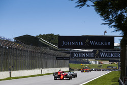 Sebastian Vettel, Ferrari SF70H, Valtteri Bottas, Mercedes AMG F1 W08, Kimi Raikkonen, Ferrari SF70H, Max Verstappen, Red Bull Racing RB13, the rest of the field at the start