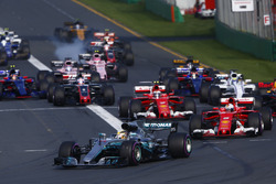 Lewis Hamilton, Mercedes AMG F1 W08, leads Sebastian Vettel, Ferrari SF70H, Valtteri Bottas, Mercedes AMG F1 W08, Kimi Raikkonen, Ferrari SF70H, and the rest of the field at the start