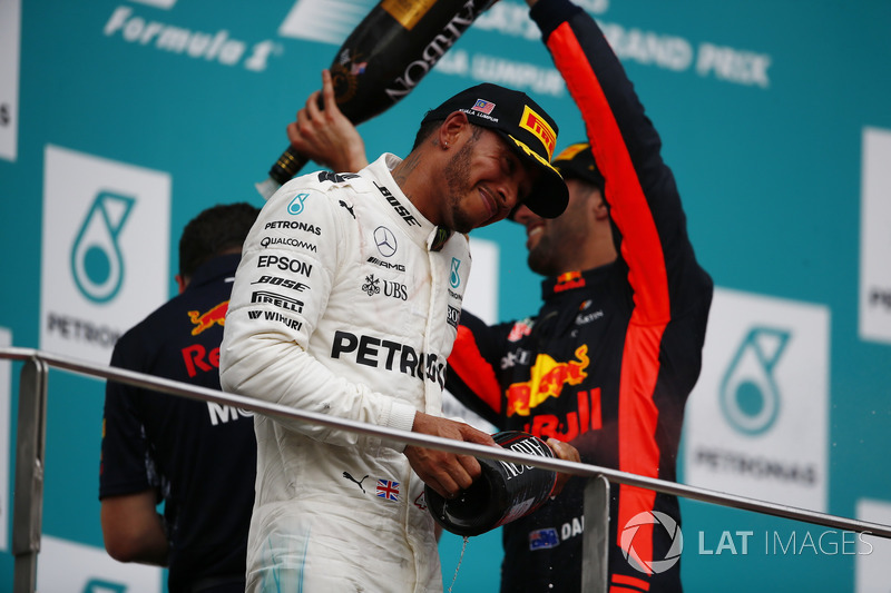 third place Daniel Ricciardo, Red Bull Racing, pours Champagne over second place Lewis Hamilton, Mercedes AMG F1, Max Verstappen, Red Bull Racing, race winner, on the podium