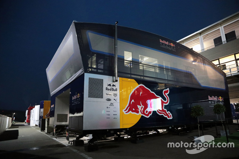 A Red Bull Racing pit building at night