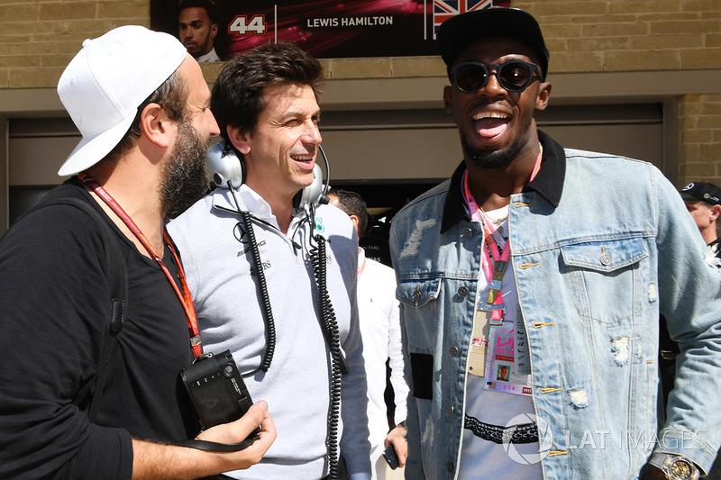 Toto Wolff, director de Mercedes AMG F1 y Usain Bolt