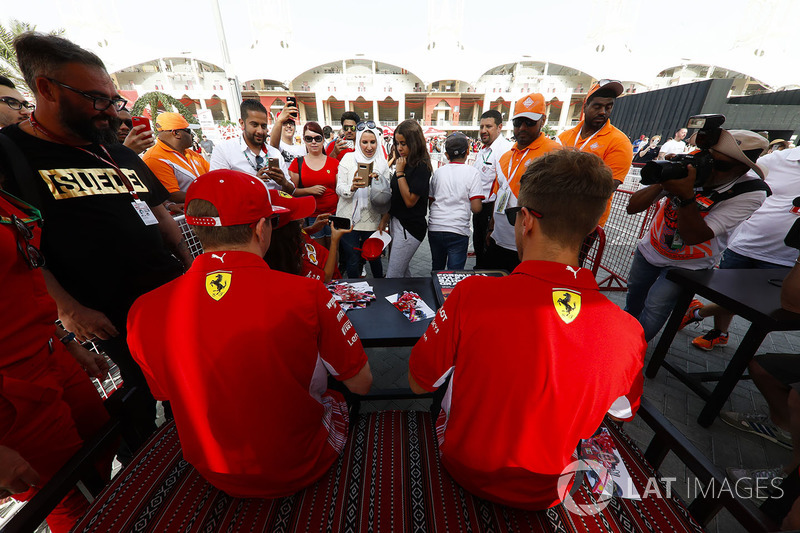 Sebastian Vettel, Ferrari, and Kimi Raikkonen, Ferrari, sign autographs for fans