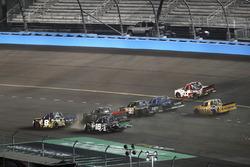John Hunter Nemechek, SWM-NEMCO Motorsports Chevrolet, Ryan Truex, Hattori Racing Enterprises Toyota, 5-wide through the apron