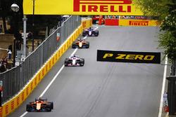 Stoffel Vandoorne, McLaren MCL33 Renault, leads Sergio Perez, Force India VJM11 Mercedes, and Fernando Alonso, McLaren MCL33 Renault