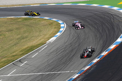 Romain Grosjean, Haas F1 Team VF-18, leads Sergio Perez, Force India VJM11, and Carlos Sainz Jr., Renault Sport F1 Team R.S. 18
