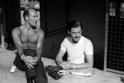Graham Hill, BRM talks with Stirling Moss